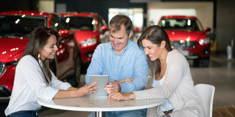 Couple Negotiating at Dealership